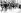 """Rebelles irlandais capturés, y compris un vieil homme barbu, marchant au pas sous escorte lors d'une fête des """"Sinn Feiners"""". Dublin (Irlande), mai 1916. © TopFoto/Roger-Viollet"""