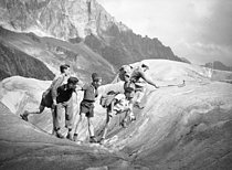Young boys crossing the Mer de glace (Sea of Ice). Chamonix (France). © Roger-Viollet