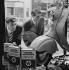 Young men looking at a Vespa in a shop window. Paris, 1955. Photograph by Janine Niepce (1921-2007). © Janine Niepce/Roger-Viollet