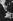 Christian Dior (1905-1957), couturier français, ajustant la jupe d'un de ses mannequins, août 1953. © Ullstein Bild/Roger-Viollet