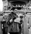 Fashion at the racecourse. Paris, July 1953. © Roger-Viollet