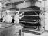 The kitchens of the Samartitaine department store. Grill gas stove Pelletier. Paris (Ist arrondissement), 1911. © Jacques Boyer / Roger-Viollet