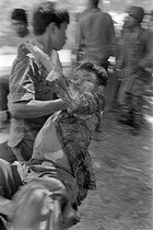 Cambodian War. Soldier transporting another one shot by a bullet from the Khmer Rouge army. Cambodia, 1974. © Françoise Demulder / Roger-Viollet