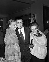 """Silvia Monfort, Alain Delon and Romy Schneider attending a gala organized for """"It's pity she is a whore"""" by John Ford. Directed by Luchino Visconti. Théâtre de Paris, March 1961. © Studio Lipnitzki / Roger-Viollet"""