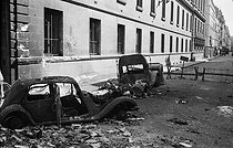 World War II. Liberation of Paris. German cars damaged by the French Forces of the Interior, near the rue de Rivoli. Paris (Ist arrondissement), on August 25, 1944. Photograph by Jean Roubier (1896-1981). © Fonds Jean Roubier/Roger-Vio
