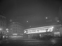 """""""CINEAC"""" movie theatre which was located on the former Gare Montparnasse train station. Paris, 1938. © Roger-Viollet"""