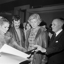 Claude Pompidou (1912-2007), wife of Georges Pompidou, President of the French Republic, Ursula Andress (born in 1936), Swiss actress, and Jean-Paul Belmondo (born in 1933), French actor, during an exhibition of children's drawings. Paris, circa 1972. © Jacques Cuinières / Roger-Viollet