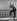 Jayne Mansfield (1934-1967), actrice américaine, à la fenêtre de l'hôtel Atlantic à Hambourg. 1957.   © Jochen Blume / Ullstein Bild / Roger-Viollet