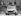 Spectateurs regardant une Mini en compétition dans le cadre du Gurston Down Hill Climb. Angleterre, 12 mai 1974. © TopFoto/Roger-Viollet