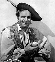 """Douglas Fairbanks (1883-1939), acteur américain, 1934-1935. Photographie extraite de """"Meet the Film Stars"""" de Seton Margrave. © TopFoto / Roger-Viollet"""