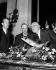 Charles Ritz, Léonce de Boisset and Ernest Hemingway, admiring a fishing trophy. © Roger-Viollet