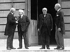 David Lloyd George, Vittorio Emanuele Orlando, Georges Clemenceau et Thomas Woodrow Wilson après la signature du traité de Versailles (Yvelines), 28 juin 1919. © PA Archive / Roger-Viollet