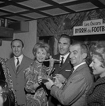 Louis de Funès and Jacqueline Gauthier. Presentation of the football Oscars. Paris, beginning of the 1960's. © Claude Poirier / Roger-Viollet
