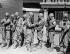 Guerre sino-japonaise (1937-1945). Exercice de protection antiaérienne. Gardes du corps de l'empereur Puyi (1906-1967) en tenue de protection s'exerçant à communiquer. Changchun (Chine), juillet 1937. © Ullstein Bild/Roger-Viollet