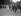 Fêtes de la Victoire à Liège (Belgique). Le président Poincaré et la reine Elisabeth de Belgique. Derrière eux, le roi Albert Ier de Belgique. Juillet 1919. © Maurice-Louis Branger/Roger-Viollet