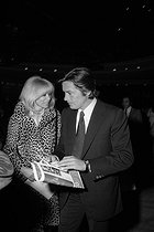 Mireille Darc (1938-2017) and Alain Delon (born in 1935), French actors, attending Sylvie Vartan's premiere at the Olympia. Paris, 1970. © Jack Nisberg / Roger-Viollet