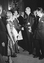 General de Gaulle and his wife, Yvonne, congratulating Gilbert Bécaud, Ludmilla Tcherina and Maurice Chevalier (at the bottom). Paris, Nignt of the chancellery, on May 30, 1959. © Bernard Lipnitzki / Roger-Viollet