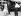 """Doris Day, James Stewart et Alfred Hitchcock visitant les souks pittoresques de Marrakech (Maroc) qui ont servi de décor au film """"L'Homme qui en savait trop"""" (The Man Who Knew Too Much), tourné en 1934. Juin 1955. © TopFoto / Roger-Viollet"""