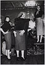 Celebrations and shows in Paris. Eddie Constantine (1917-1993), American-born French actor and singer, dancing with a young woman, rue de Lappe. Paris (XIth arrondissement), 1956. Photograph by Jean Marquis (1926-2019). Bibliothèque historique de la Ville de Paris. © Jean Marquis / BHVP / Roger-Viollet