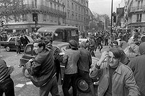 """May-June 1968 events. Student riot in the Latin Quarter, at the corner of the boulevard Saint-Germain and the rue Saint-Jacques. Paris (Vth arrondissement), on May 6, 1968. Photograph by Jacques Boissay and Bernard Charlet, from the collections of the French newspaper """"France-Soir"""". Bibliothèque historique de la Ville de Paris. © Boissay,Charlet / Fonds France-Soir / BHVP / Roger-Viollet"""