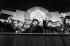 Célébration du 35ème anniversaire de la fondation de la RDA. Vue de la tribune pendant la retraite des flambeaux de l'armée populaire nationale allemande (Nationale Volksarmee). De gauche à droite : Egon Krenz, Helga Labs,  Andrei Gromyko, Erich Honecker. 7 octobre 1984. © Ullstein Bild/Roger-Viollet