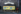 """Affiche publicitaire pour le désodorisant de la marque """"PureOdor"""" sur des vespasiennes dans le quartier des Halles. Paris (Ier arr.), février 1969. Photographie de Léon Claude Vénézia (1941-2013). © Léon Claude Vénézia/Roger-Viollet"""