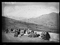"""Spanish civil war (1936-1939). """"La Retirada"""". Spanish refugees having a break before going down to Prats-de-Mollo-la-Preste, carrying some things after walking through the arduous mountain paths. January 28, 1939.    Photograph from the Excelsior newspaper. © Excelsior – L'Equipe/Roger-Viollet"""