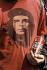 Personne portant un tee-shirt à l'effigie d'Ernesto Che Guevara (1928-1967), révolutionnaire argentin, et une bouteille de Coca-Cola lors d'une manifestation. 1998.  © Ullstein Bild / Roger-Viollet