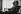 Eugène Ionesco (1909-1994), auteur dramatique français d'origine roumaine, avec sa collection de masques. Paris, boulevard du Montparnasse, 1965.  © Jean Mounicq / Roger-Viollet