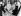 Mohamed Ali (anciennement Cassius Marcellus Clay, 1942-2016), boxeur américain, son épouse Sonji Roi, et le docteur J. Sacchetti, après une opération ayant entraîné l'annulation de son combat contre Sonny Liston. Hôpital de Boston (Etats-Unis), 21 novembre 1964. © TopFoto / Roger-Viollet