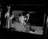 Le prince Charles saluant la foule tandis qu'il se rend à Balmoral avec ses parents et sa soeur Anne. Buckingham Palace (Angleterre), 27 mai 1955. © TopFoto/Roger-Viollet