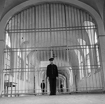 Prison of Fresnes (Val-de-Marne, France). Corridor and the large metal gate. 1947. © Gaston Paris / Roger-Viollet