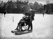 Young people on sleigh on the ice of the lake of the Boulogne woods. Paris, January 1907. © Jacques Boyer/Roger-Viollet