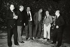 Luigi Comencini, Frank Capra, Michelangelo Antonioni, Sergio Leone, Roberto Rossellini et Gillo Pontecorvo photographiés ensemble dans un parc.     © Alinari / Roger-Viollet