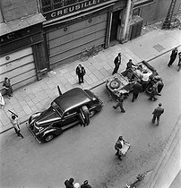 "World War II. Liberation of Paris. Beginning of the Parisian insurrection. Vehicule of the French Forces of the Interior, Kübelwagen vehicule taken from the Germans and ammunition boxes. Photograph by Jean Roubier (1896-1981), taken from the premises of the newspaper ""Paris-Soir"". Paris (IInd arrondissement), rue du Mail, August 20, 1944. © Fonds Jean Roubier/Roger-Vio"