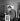 Serge Gainsbourg (1928-1991), chanteur et compositeur français, et une de ses peintures. © Claude Poirier / Roger-Viollet