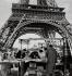 Man selling miniatures of the Eiffel Tower. Paris (XVIth arrondissement), 1956. Photograph by Janine Niepce (1921-2007). © Janine Niepce / Roger-Viollet