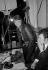 "Claude François (1939-1978), Egyptian-born French singer, and Paul Lederman (born in 1940), his impresario, at the Europe N°1 studio for the ""Salut les Copains"" radio program. Paris, 1962. © Noa / Roger-Viollet"