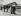 Boites de bouquiniste sur le quai Saint-Michel, marchande et curieux. Paris. Photographie de Jean Roubier (1896-1981), avant 1938. Bibliothèque historique de la Ville de Paris. © Jean Roubier / BHVP / Roger-Viollet