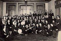 Group photograph with a traditional musical instrument. © Archives Manouchian / Roger-Viollet