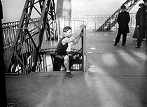 Eiffel Tower race. A competitor taking the stairs. Paris, on September 9, 1906. © Maurice-Louis Branger / Roger-Viollet