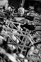 "Raymond Poulidor (1936-2019), French racing cyclist, selling ""Poulidor"" bicycles in a Leclerc hypermarket. France, 1998. © Jean-Pierre Couderc / Roger-Viollet"