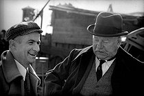 "Jean Gabin (1904-1976) and Louis de Funès (1914-1981), French actors, on the set of ""Le Tatoué"", film by Denys de La Patellière. 1968. Photograph by Georges Kelaïditès (1932-2015). © Georges Kelaïditès / Roger-Viollet"