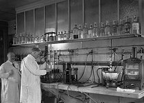 Professor Kohn-Abrest's toxicology laboratory at the prefecture of police. Extraction of alkaloids. Paris, 1927. © Jacques Boyer / Roger-Viollet
