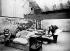 """Claude Monet (1840-1926), peintre français, peignant ses """"Nymphéas"""" dans son atelier de Giverny (Eure). Photographie d'Henri Manuel (1874-1947). © Henri Manuel / Collection Harlingue / Roger-Viollet"""