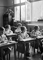 Class in a primary school in Suresnes (France). 1930's. © Laure Albin Guillot / Roger-Viollet