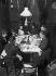 Family dinner. Photograph Henri Roger. France, 1891. © Henri Roger / Roger-Viollet