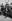 """Vincent Scotto (1876-1952), compositeur français, entre Tino Rossi (1907-1983) et Paul Azaïs pendant le tournage de """"Au son des guitares"""", film de Pierre-Jean Ducis. Marseille (Bouches-du-Rhône), 1936. © Roger-Viollet"""