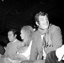 Jean-Paul Belmondo, Ursula Andress and Jean Rochefort at the Bilboquet. Paris, December 1967. © Studio Lipnitzki/Roger-Viollet