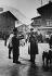 Woman buying a newspaper. Megève (Haute-Savoie), 1954. Photograph by Janine Niepce (1921-2007). © Janine Niepce / Roger-Viollet